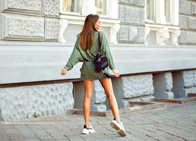 Fashion lifestyle image of fashionable hipster woman posing on the street Free Photo
