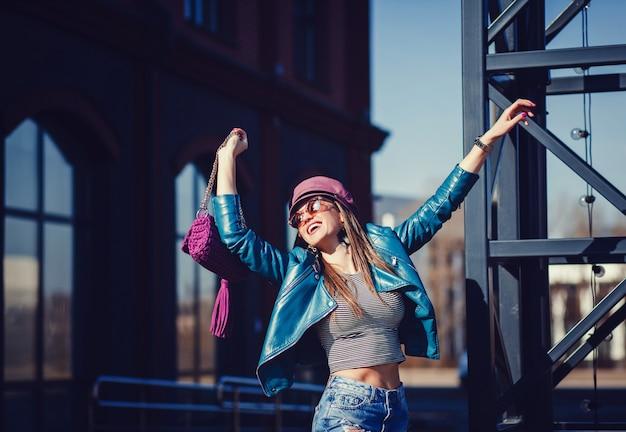 Fashion model in sunglasses, leather jacket Premium Photo