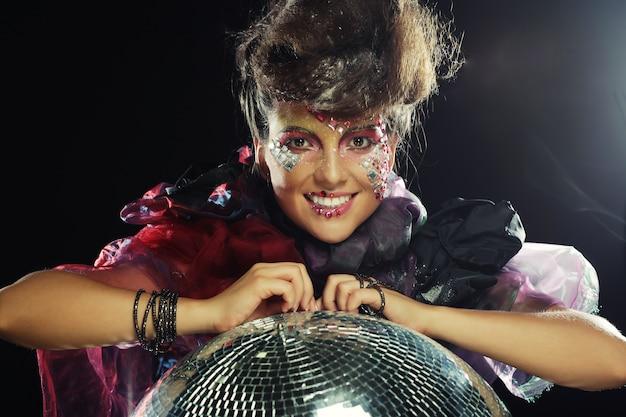 Fashion portrait of a beautiful model with creative make up Premium Photo