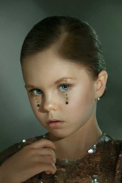 The fashion portrait of young beautiful preteen girl at