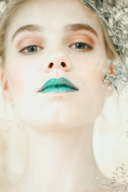 Fashion portrait of young blond woman.beautiful girl with green lips. concept mother nature Premium Photo