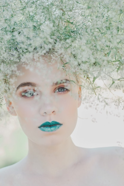 Fashion portrait of young blond woman, beautiful woman with green lips. concept of mother nature Premium Photo