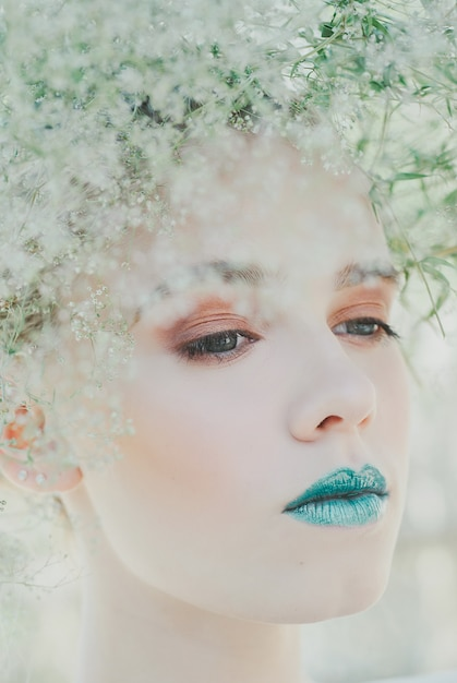 Fashion portrait of young blond woman. beautiful woman with green lips. concept of mother nature Premium Photo