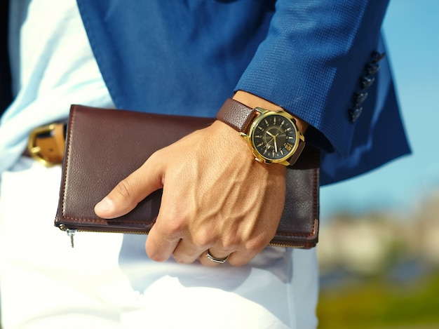Fashion portrait of young businessman handsome model man in casual cloth suit with accessories on hands Free Photo