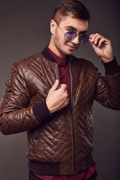 Fashion portrait of young handsome man with aviator glasses Premium Photo