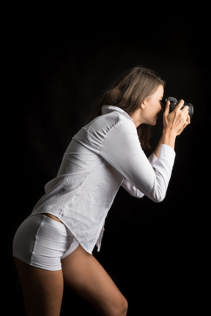 Fashion portrait of young woman photographer with camera Free Photo