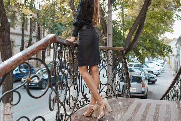 Fashion pretty woman walking through the streets of old city Free Photo