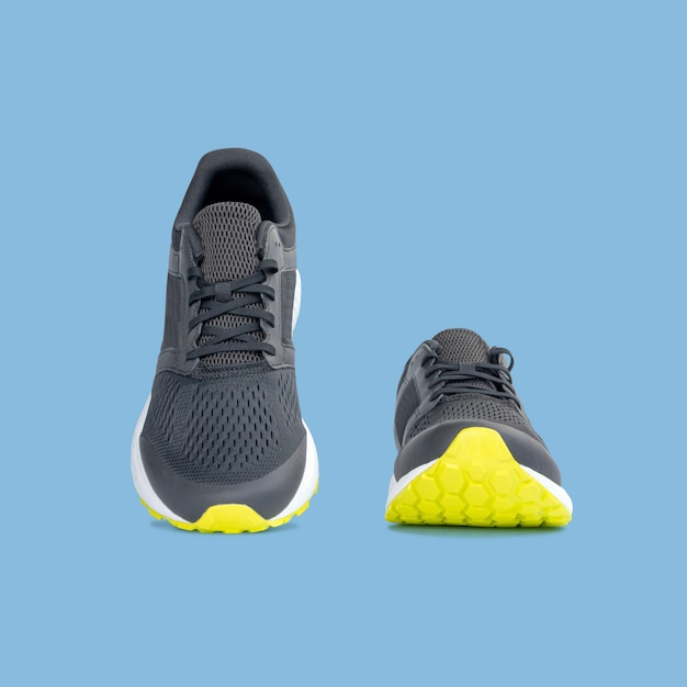 Fashion running sneaker shoes isolated on beautiful pastel color background, with clipping path. Premium Photo