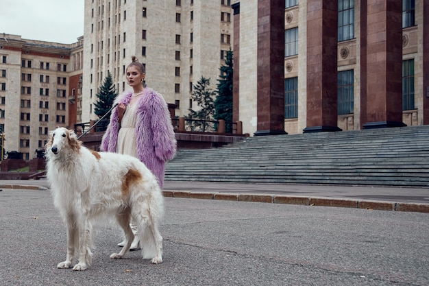 Fashion type photo of a stylish woman with a dog Premium Photo