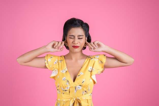 Fashion woman hand cover her ears Free Photo