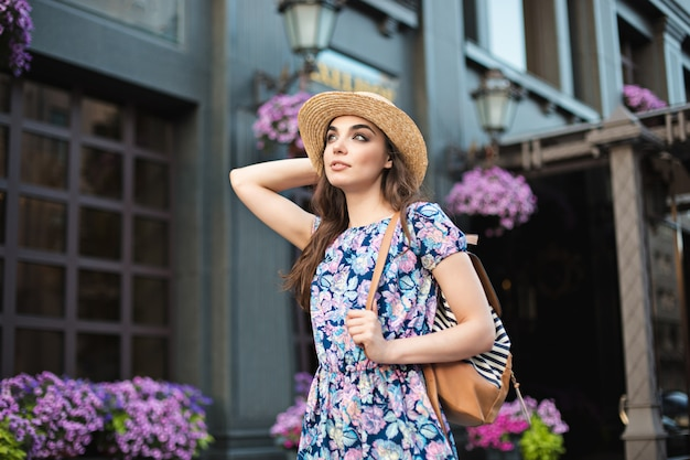 The fashion woman portrait of young pretty trendy girl posing at the city in europe Free Photo