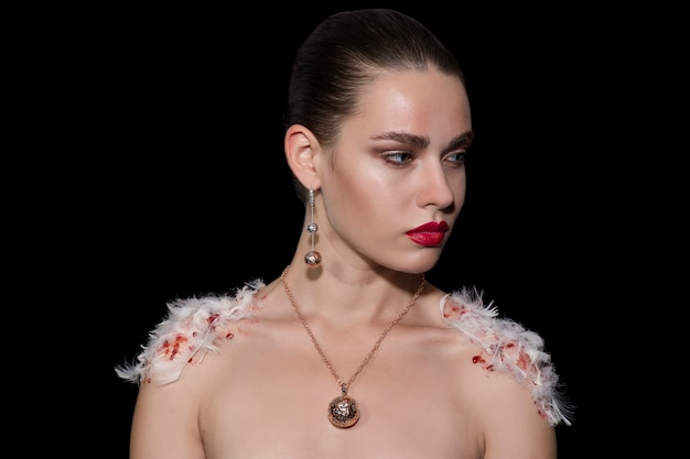 Fashion Shoot Shows Models Beaten Bloody: Fashion Woman With Feathers Photo