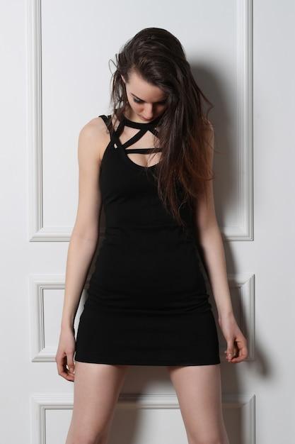 Fashion young woman posing with black dress Free Photo