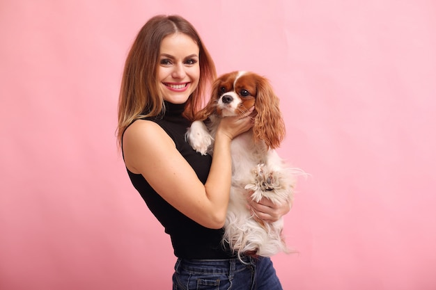 Fashion young woman posing with dog Free Photo