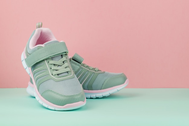 Fashionable gray sneakers on a blue and pink Premium Photo