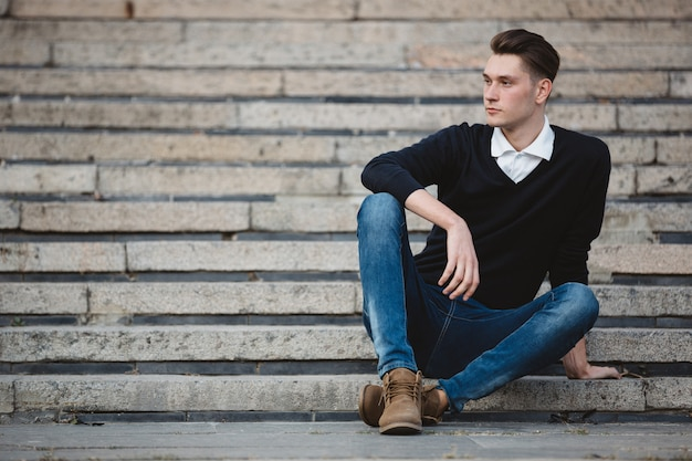 Fashionable handsome man model posing Free Photo