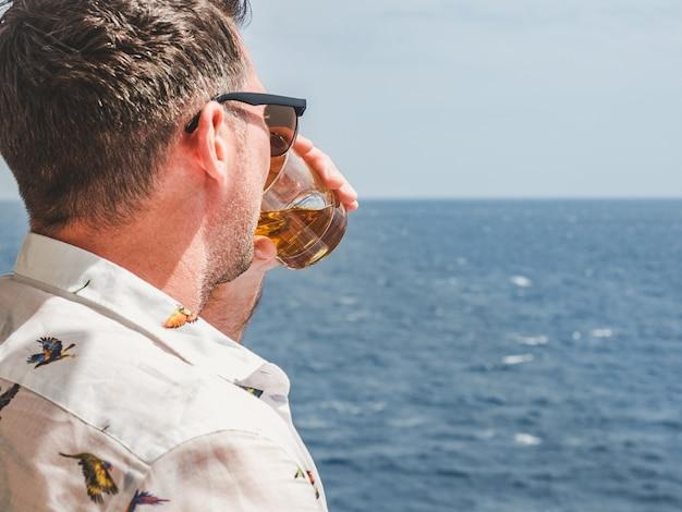 Fashionable man holding a beautiful glass Premium Photo