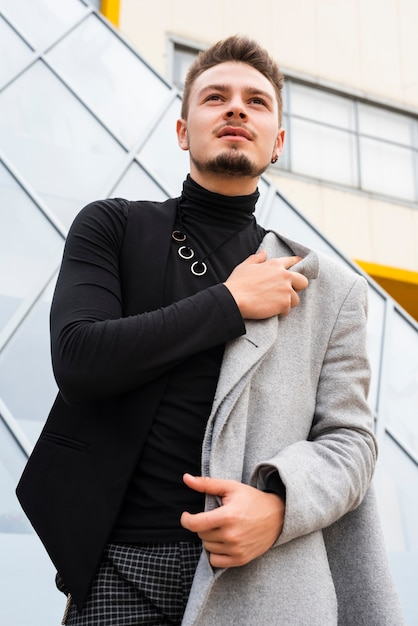 Fashionable man looking away from camera Free Photo