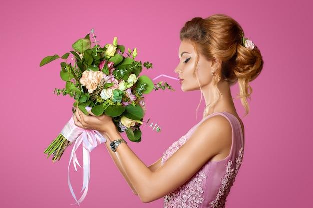 Fashionable model smelling a perfume on white Premium Photo