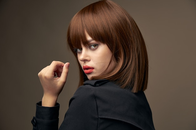 Fashionable woman in jacket gesticulate with hands room Premium Photo