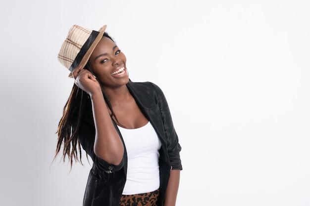 Fashionable young beautiful african woman with posing in black leather jacket. Premium Photo