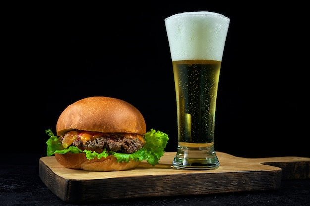 Premium Photo Fast Food And Cold Light Beer Burger Placed On A Wooden Board On Bar Counter With Copy Space