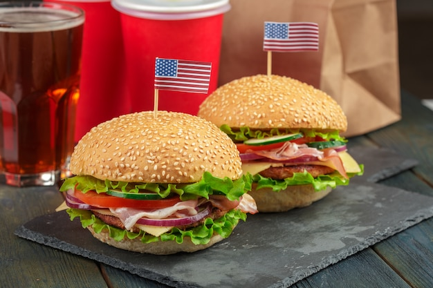 Fast food, homemade burger on a wooden background Premium Photo