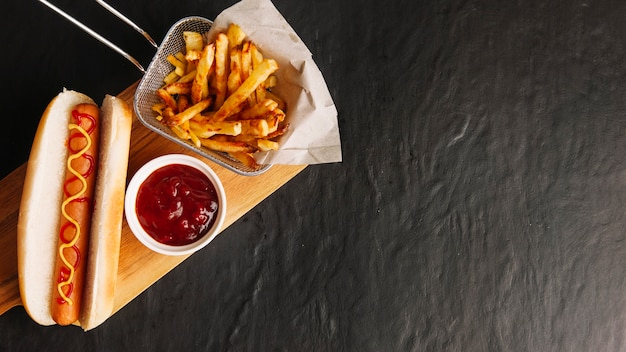 Fast food on wooden board and space on right Free Photo
