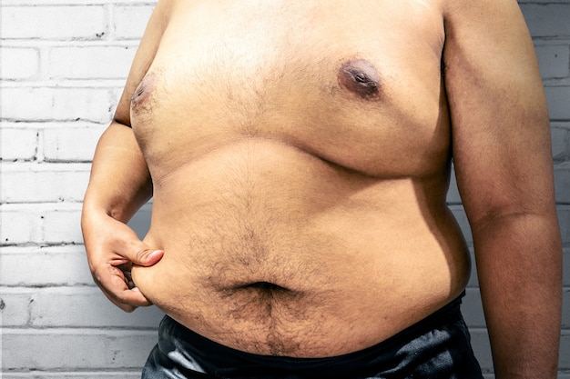 Fat man with his big belly Premium Photo