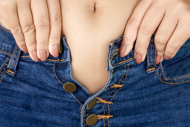 Fat woman try to wear tight jeans Premium Photo