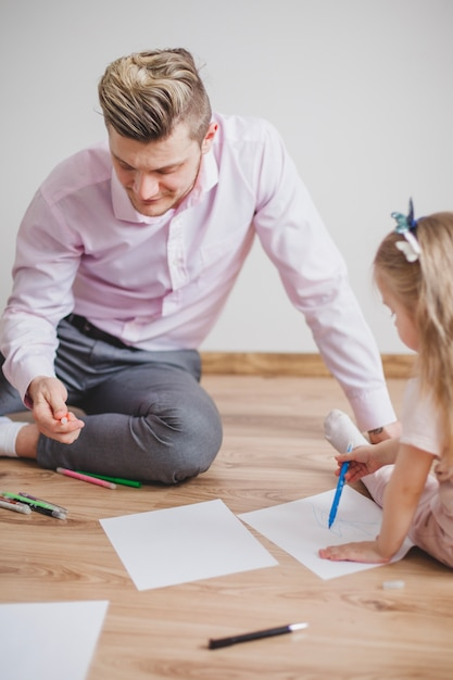 Father And Daughter Sitting On The Floor Drawing Photo Free Download