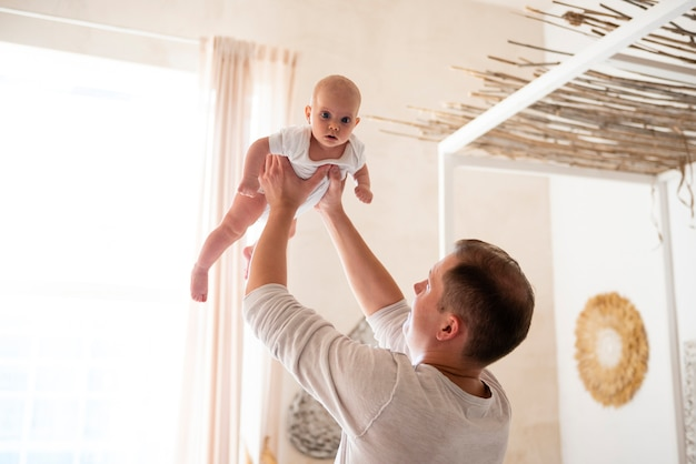 Father being playful with baby Free Photo