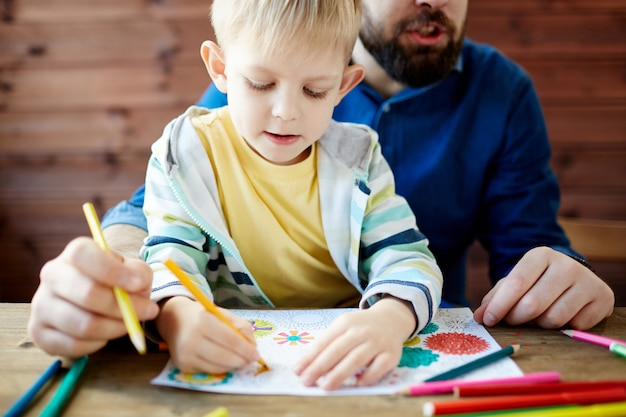 Father and child coloring Free Photo