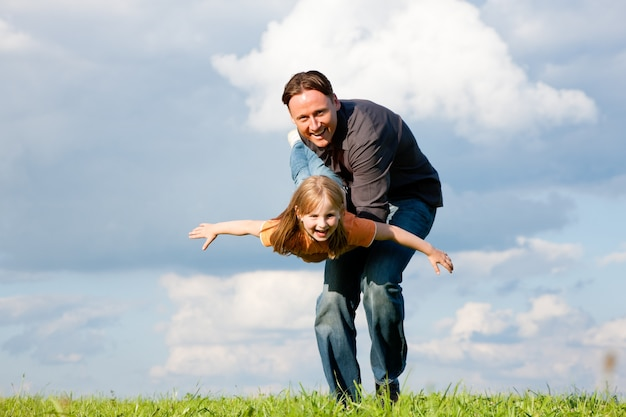 Father and child playing together Premium Photo