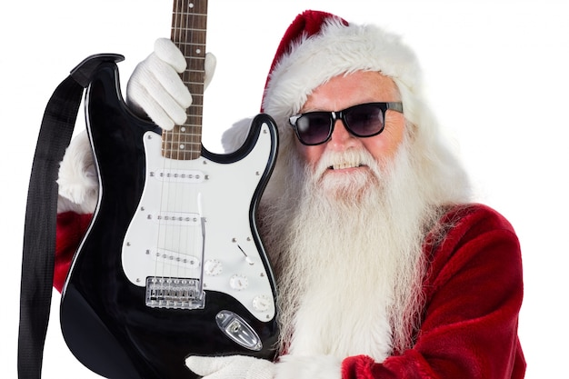 Father christmas shows a guitar Premium Photo