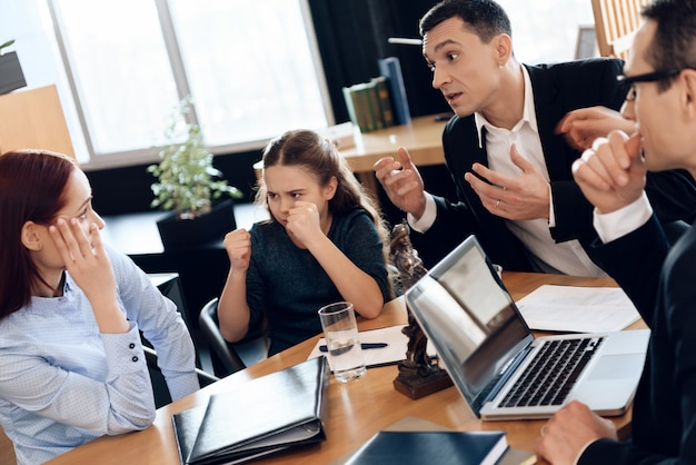 Father and daughter are angry with mother in office. Premium Photo