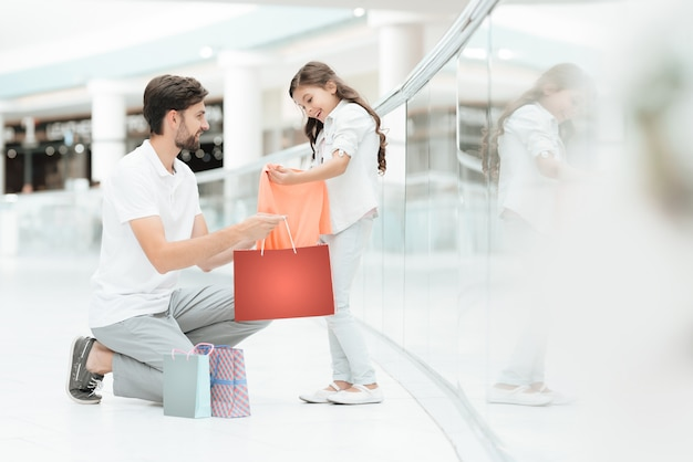 Father and daughter bought new sweater in shopping mall. Premium Photo
