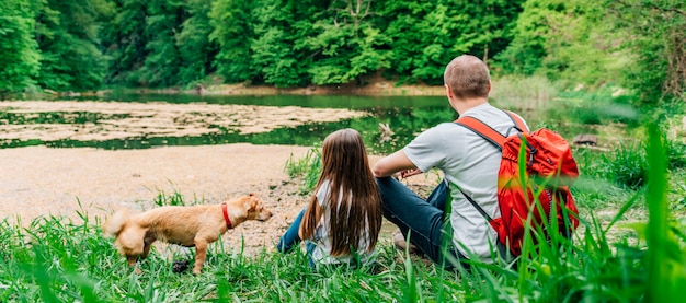 Father and daughter by the lake with the dog Premium Photo