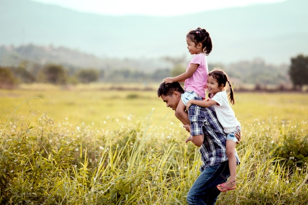 Father and daughter having fun and playing together in the cornfield Premium Photo