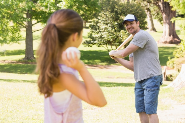 Father and daughter playing baseball Premium Photo