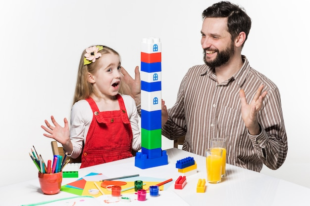 Father and daughter playing educational games together Free Photo