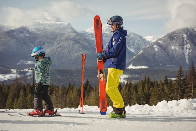 Father and daughter skiing on snowy alps Free Photo