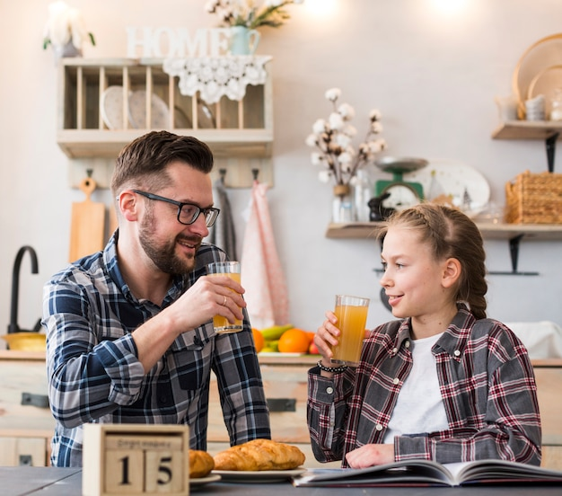 Father and daughter together on breakfast table Free Photo