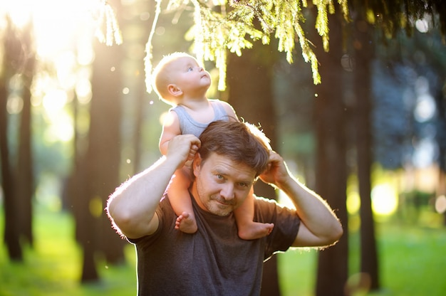 Father and his son at sunset Premium Photo