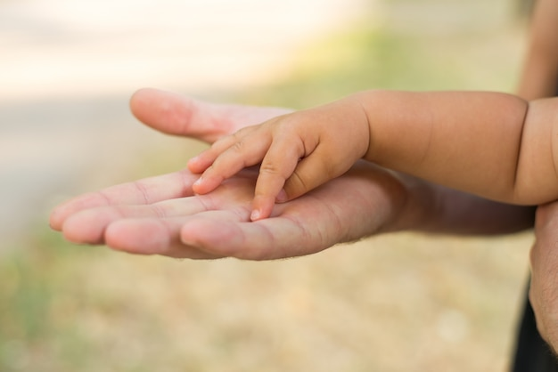 Father holding his daughter's hand. Premium Photo