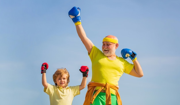 Father is training his son boxing. little boy sportsman at boxing training with coach. Premium Photo