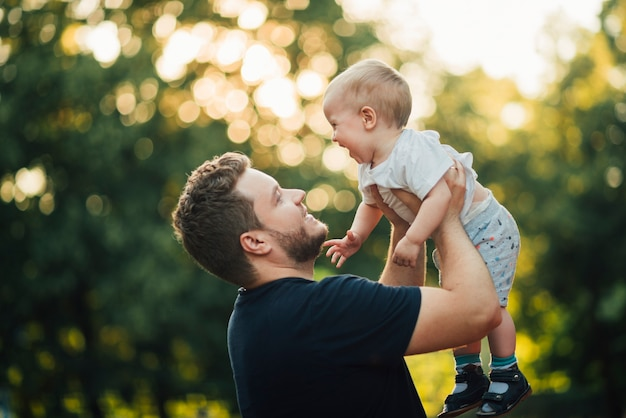Father lifting his son in the air Free Photo