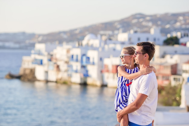 Father and little girl in little venice in mykonos Premium Photo