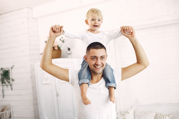 Father and little son have fun at home Free Photo