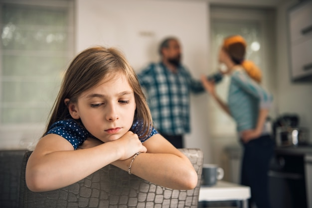 Father and mother arguing in front of daughter Premium Photo